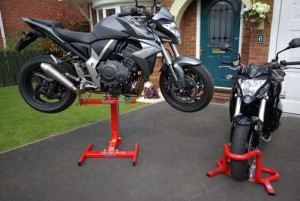 Lift and wheel chock combination for motorcycles