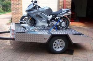 Motorcycle trailer designed to use Bikegrab wheel chock