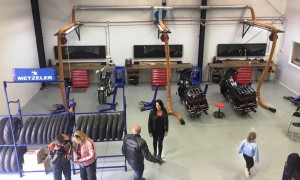Motorcycle service bay using Big Blue professional motorcycle lift