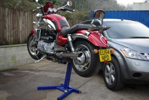 Triumph Rocket 3 lifted for cleaning on Big Blue